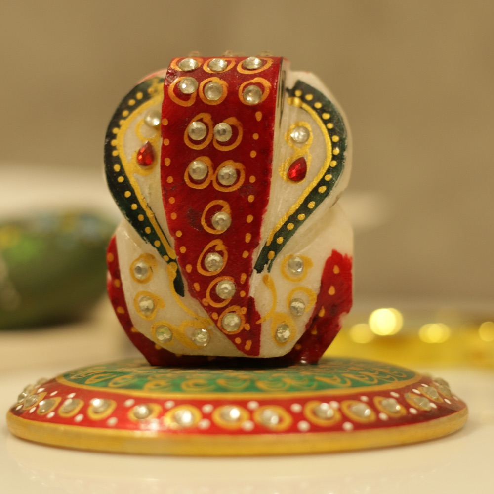 Marble Ganesh on round platform with Pearls